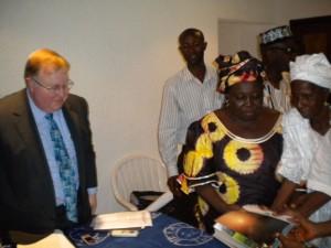 Madam Satta Kaikai (2nd from right) handing over the report to Deputy American Ambassador to Sierra Leone-Glen Fedzer