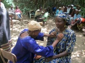 Women practicing trauma tapping