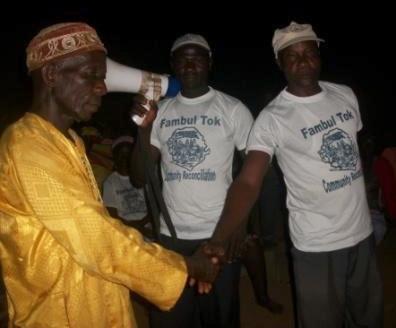 Chief Komba Sebba shakes hand with his brother Aiah Sebba