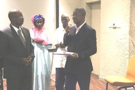 Handing over Delmandugu Chiefdom development plan to the Minister